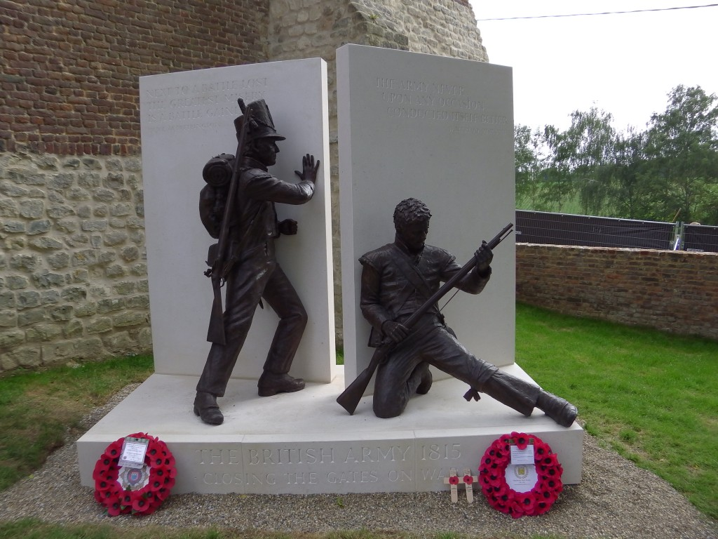 Statue of the guards shutting the doors of Hougoumont
